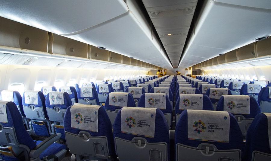 quảng cáo sau lưng ghế trên máy bay