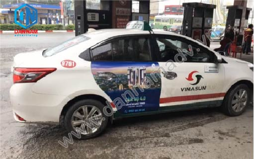 Bất Động Sản 6 Miles Coast - Quảng cáo trên taxi Bình Dương